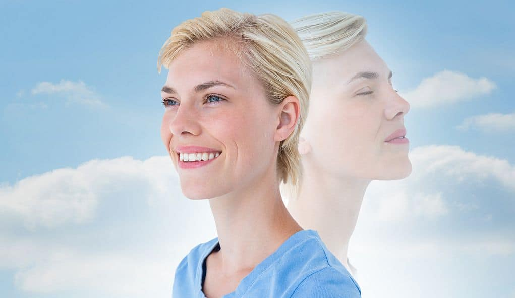 Woman focusing on her breathing as part of holistic health and wellness