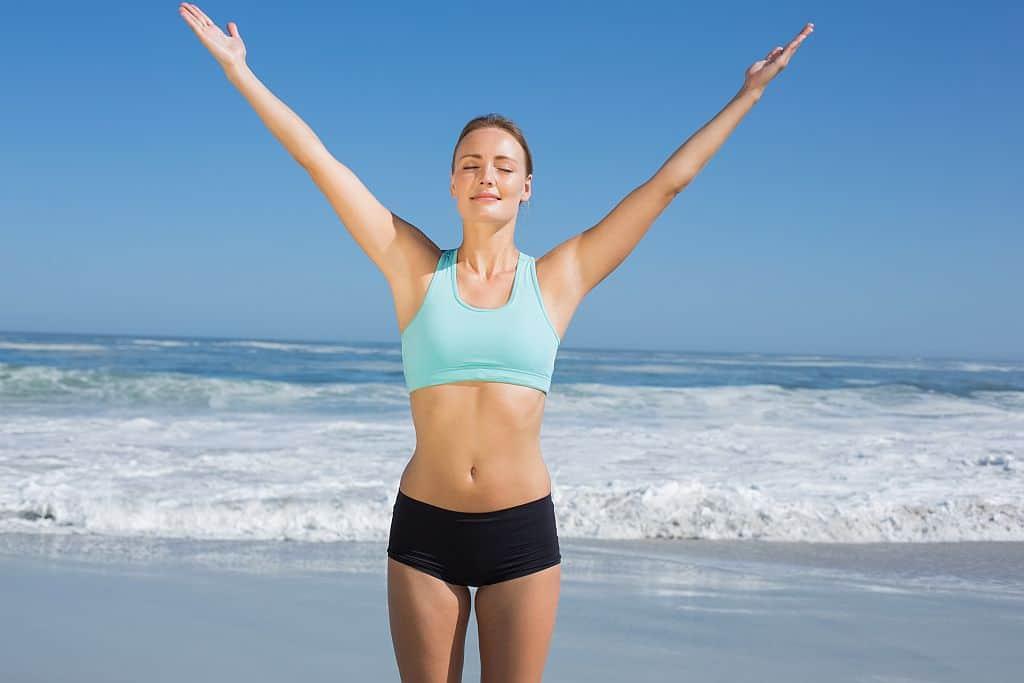 girl on beach with sports bra