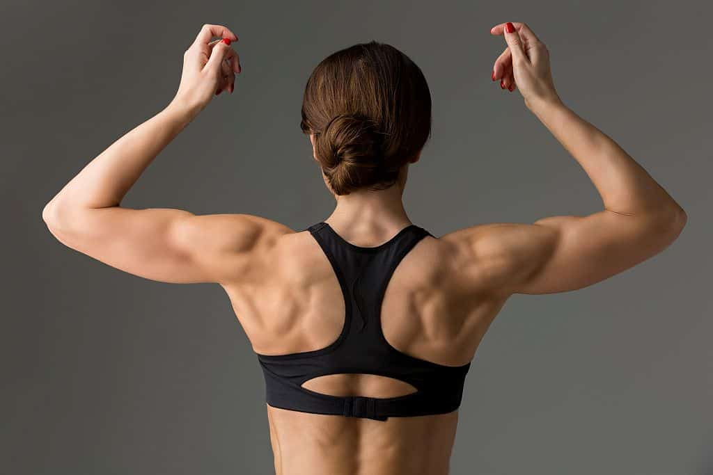 Fit woman with superb back muscles