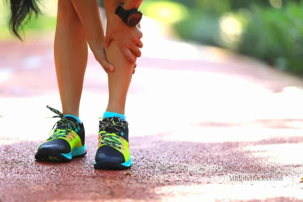 Woman stopped running and self massaging her shin splints
